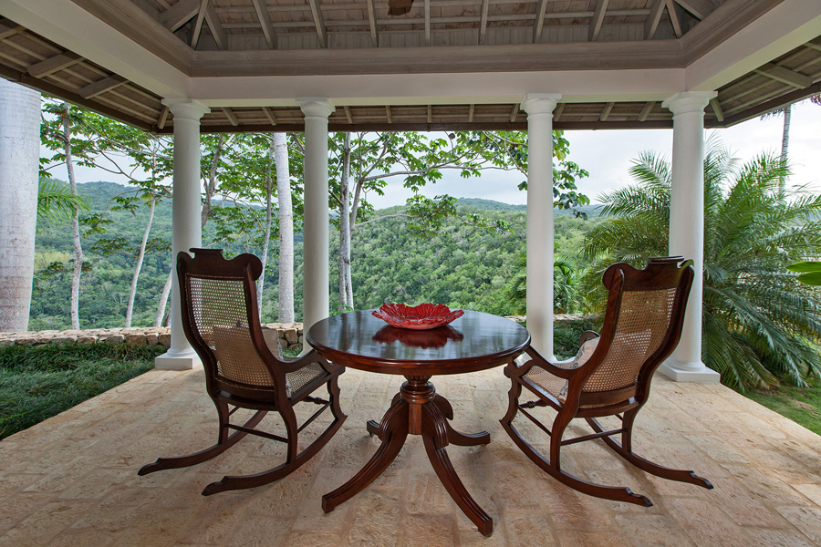 a custom-designed private balcony for two. To waken here is poetry as the morning sun touches the heavily-forested mountain across the valley. Eye-opener coffee is silently left by the butler