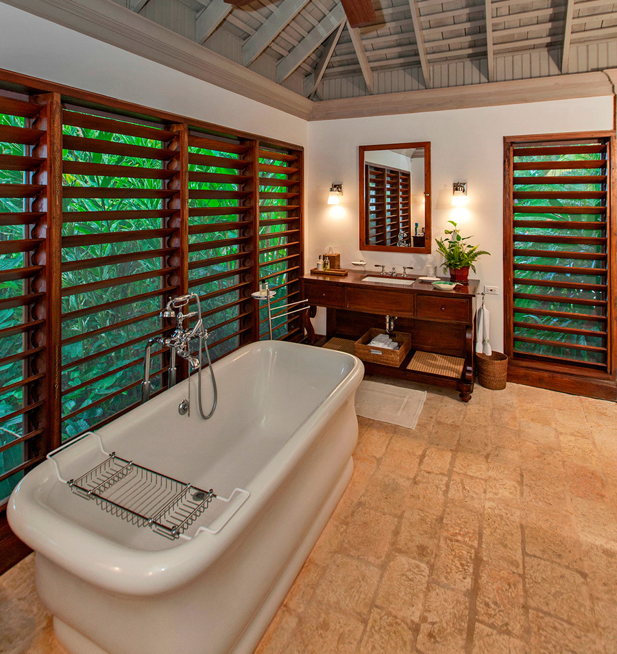 The en-suite bathroom has a deep bathtub and large marble walk-in shower with 2 shower-heads.  A 15' louvered window wall provides a lush garden view and privatizes this bathroom.