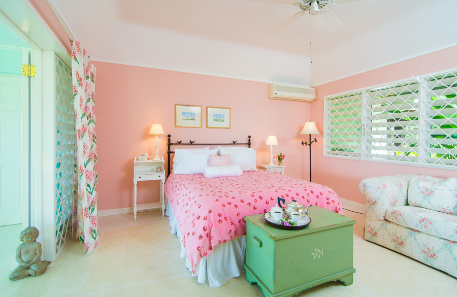 PINK ROOM Double bed in fanciful pale pink room, French doors to verandah.