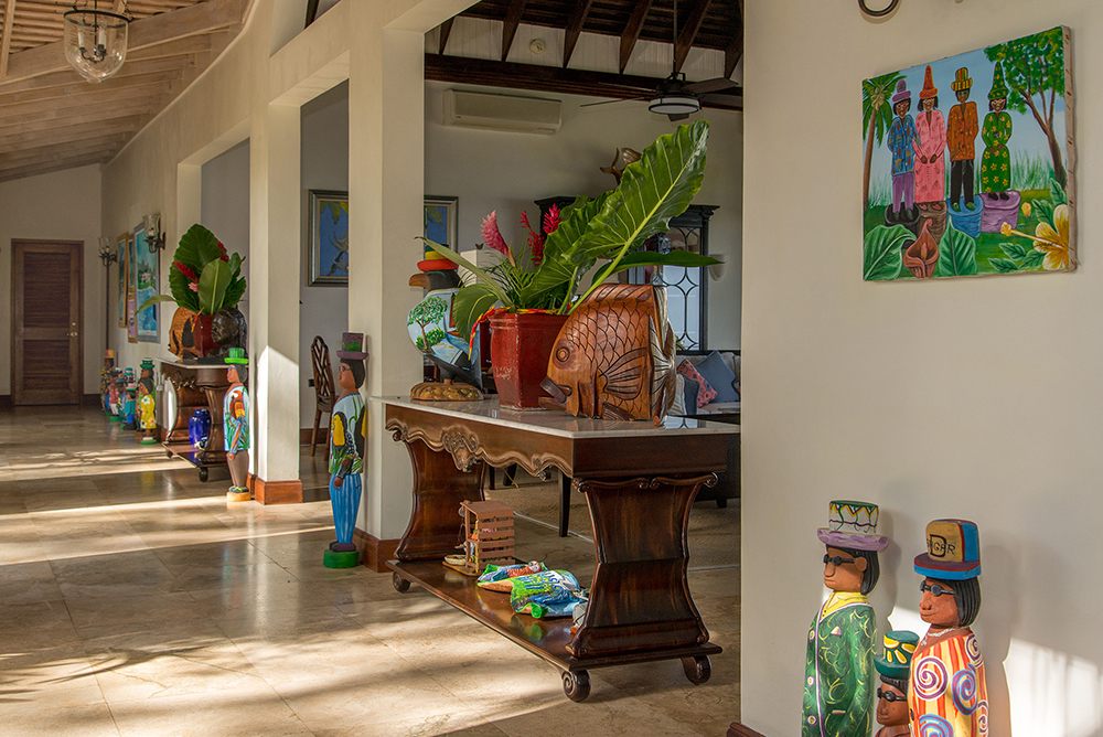 ACCOMMODATIONS In the Main Villa, a colorful corridor leads to  four private bedrooms, glamorous and comfortable in Colonial style.