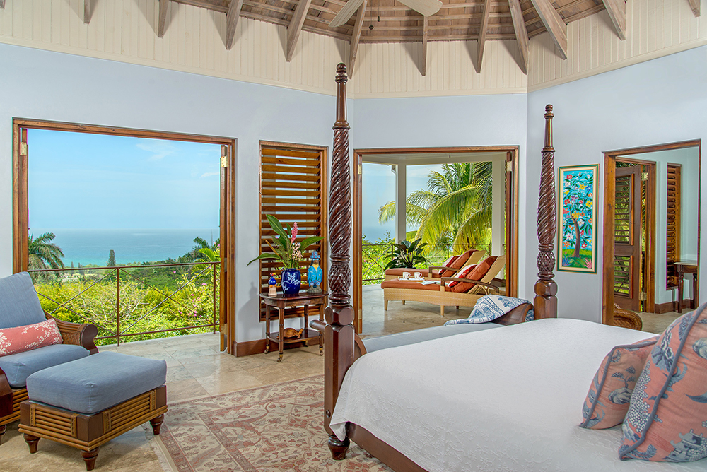 The master suite opens to a private gazebo-style porch with comfy chaises and a mesmerizing blue view of Caribbean Sea ...