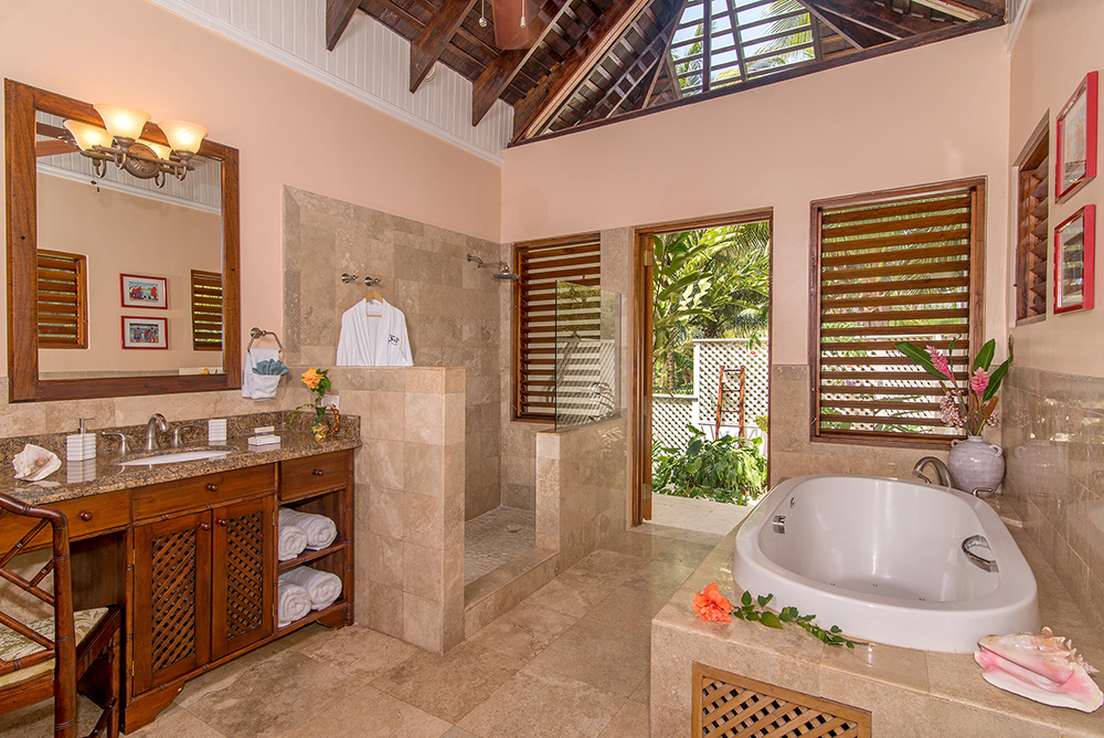From the glamorous master bathroom ...