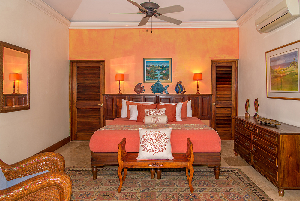 Bedroom 2 in tropical melon can be king- or twin-bedded and allows convenient proximity for parents and children occupying these two side-by-side bedrooms.