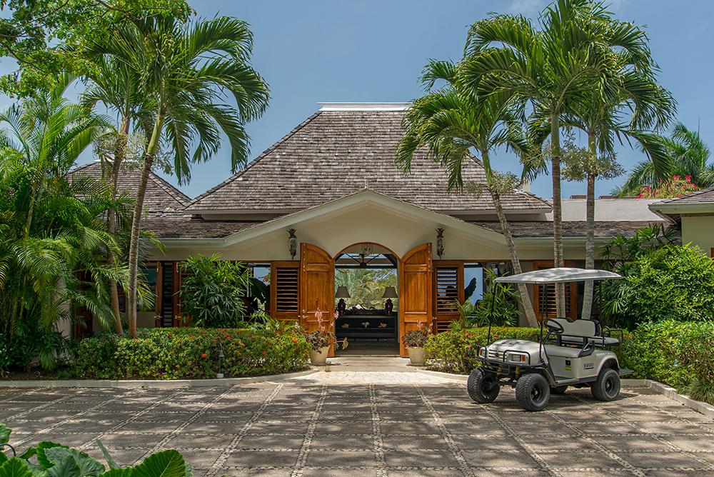Enter the Main Villa through palm-fringed double doors.