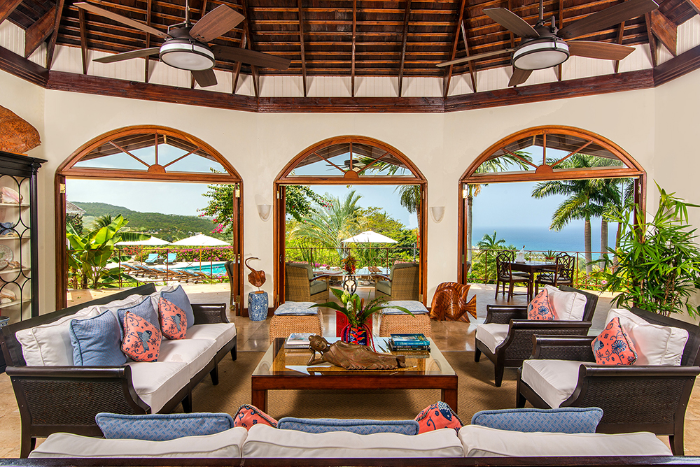 Step into the Great Room with high rafter-and-beam ceiling and arched French doors to the balcony verandah and a breathtaking panorama of manicured lawns and gardens, pool and hot tub, and th