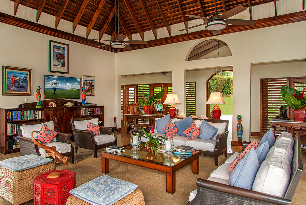Inside, under a tall rafter-and-beam ceiling, the colorful Living Room is spacious and comfortable ... and includes many entertainment features.
