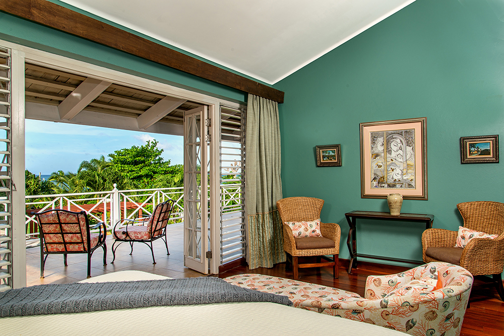 Bedroom  3 & 4 also have French doors open onto the veranda with far reaching sea views.