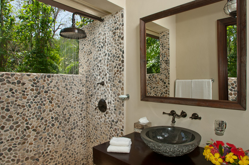 Thoughtful planning led to the full bathroom just few barefoot steps beyond the pool and bar.