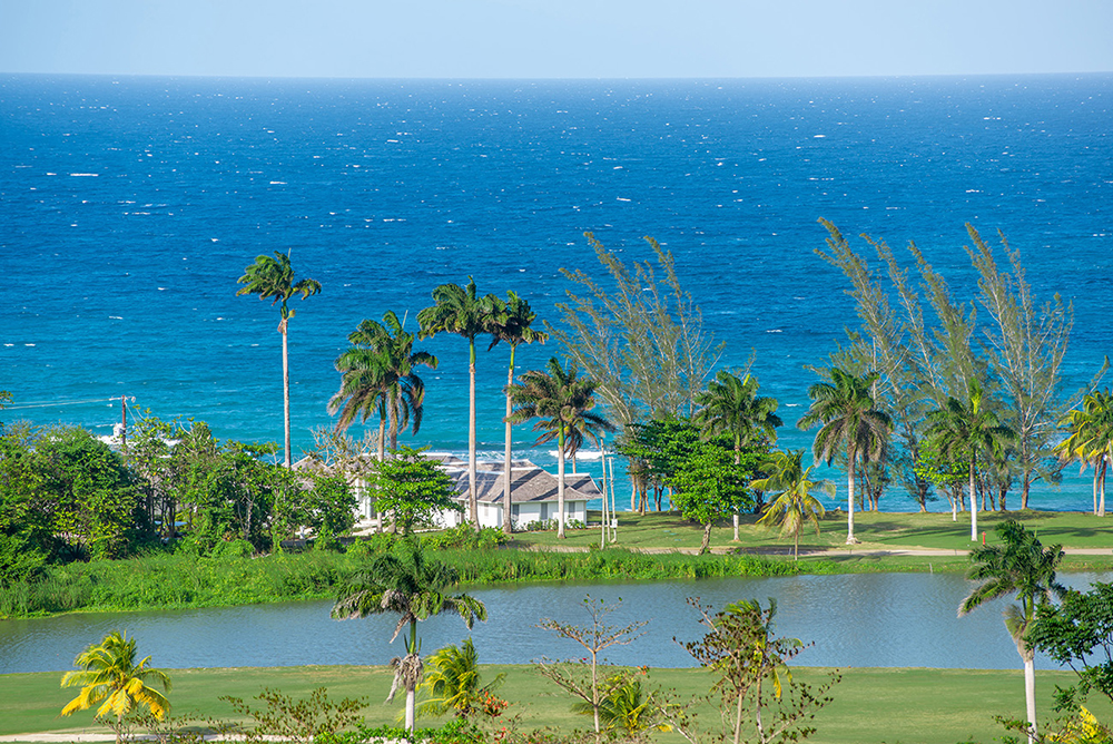 This plum site is one of only six villas located directly on the Caribbean shore on this private cul-de-sac lane.