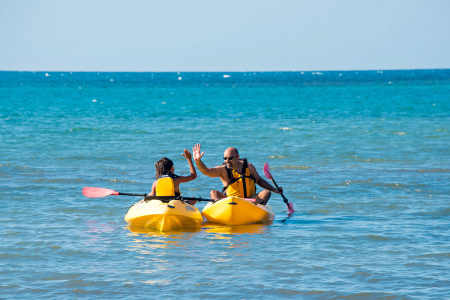 Easily reachable by kayak, at low tide, portions of the reef protrude above the water so you can step from your kayak to snorkel in shallow water.  On the Caribbean side, deeper waters beck