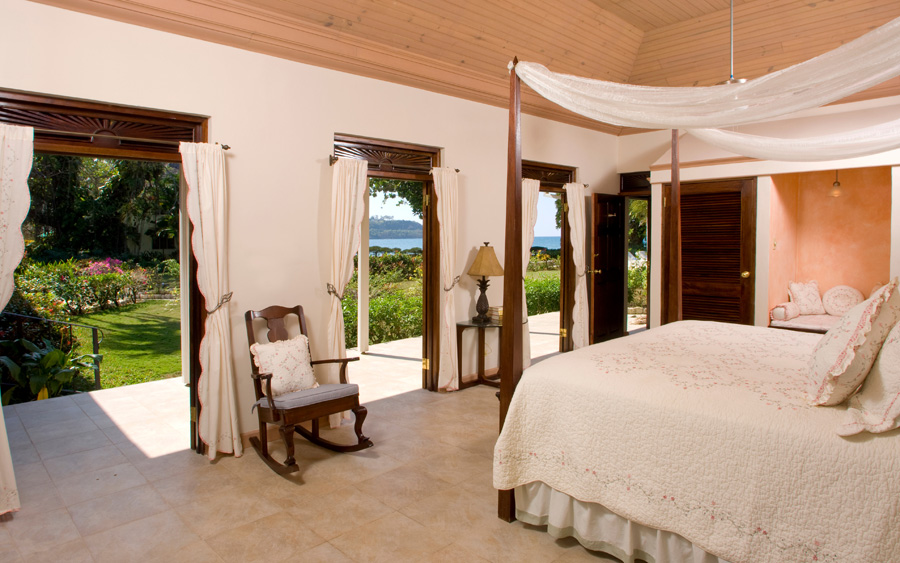 Master Bedroom 2 was added to increase Tranquillity to 6 bedrooms. Louvered mahogany doors open to the view over the lawn and gardens to the sea.