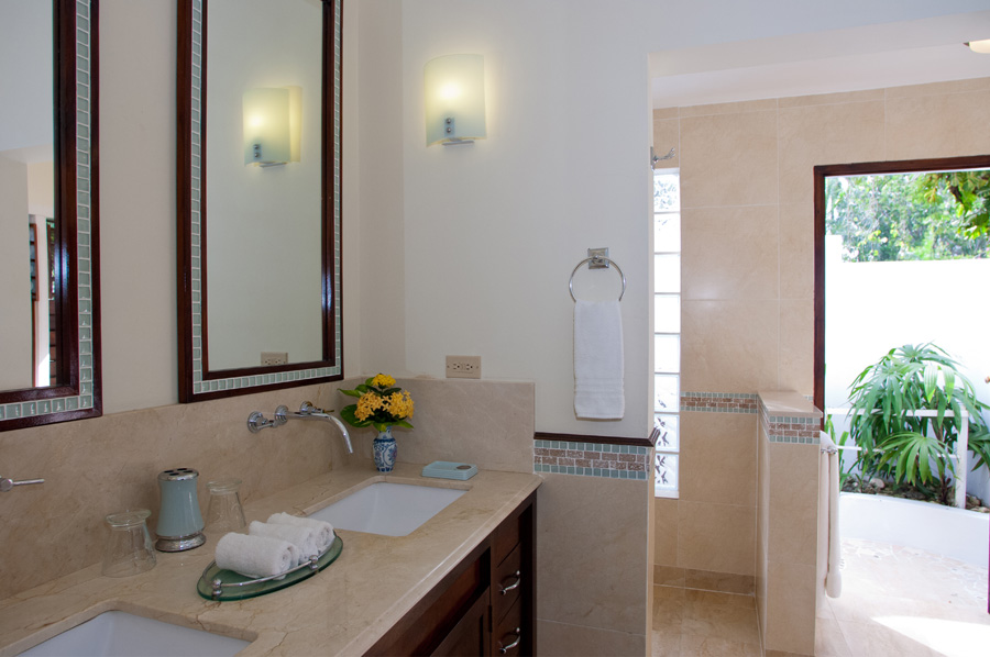 ... en-suite bathroom with walk-in shower. French doors open to a private patio and the tennis court a few steps across the lawn.