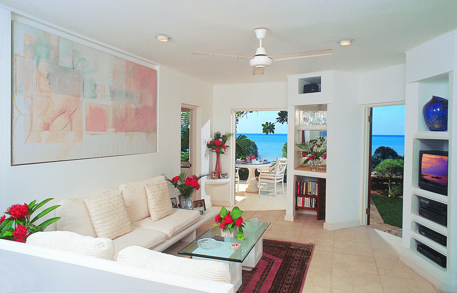 The lower level consists of the living room, queensize guest bedroom, and full bathroom with connecting outdoor shower.