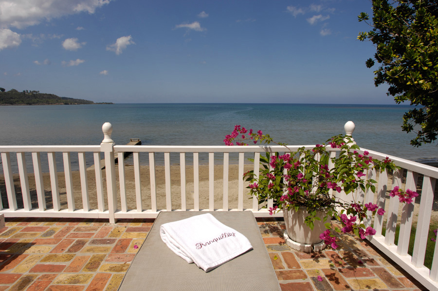 ... the pièce de resistance: the over-the-beach balcony with cushioned lounges for sunning or star-gazing.