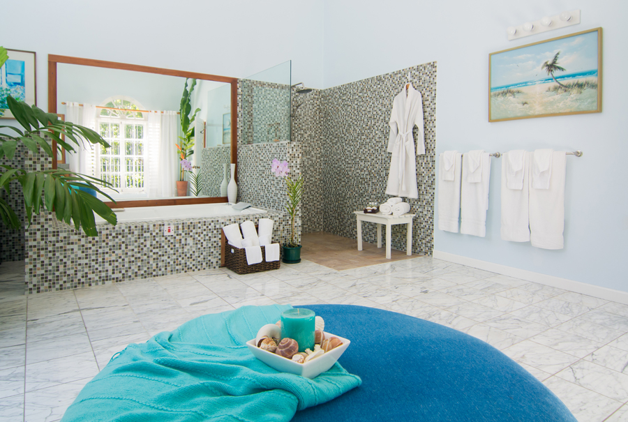 ... and oversize bathroom with deep Jacuzzi tub for two and large open shower.