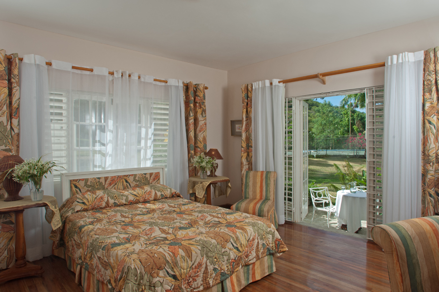 DOWNSTAIRS ACCOMMODATIONS  BEDROOM 4 Queen bed.  En-suite bathroom has a tub-shower combination.  Side doors can remain locked when children occupy this room.  Interior door to Bedroom 5 a